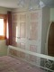 Guest bedroom 1 with king size bed and hand painted fitted wardrobes